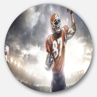 Designart 'American Footballer on Stadium' Sports Photo Round Wall Art