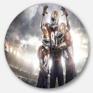 Designart 'American Football Players on Stadium' Sports Disc Metal Wall Art