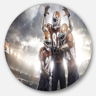 Designart 'American Football Players on Stadium' Sports Disc Metal Wall Art