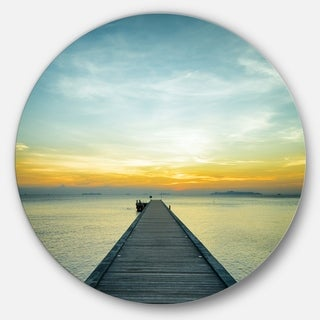 Designart 'Boat Pier at Sunset' Seascape Photo Circle Wall Art
