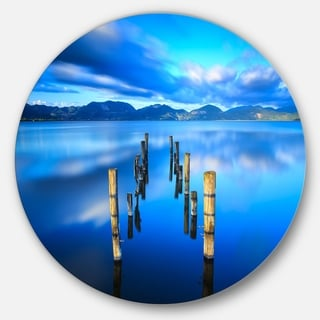 Designart 'Wooden Pier Remains in Blue Sea' Seascape Photo Large Disc Metal Wall art