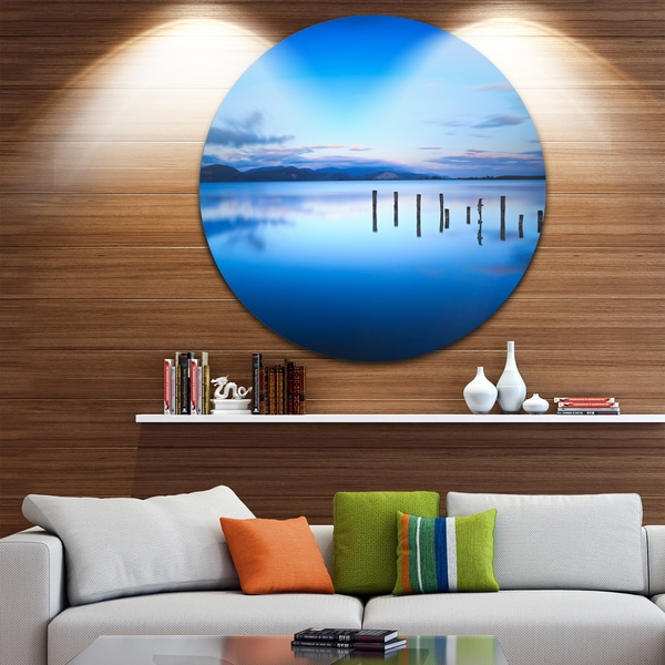 Designart 'Jetty Remains in Blue Sea' Seascape Photo Circle Wall Art