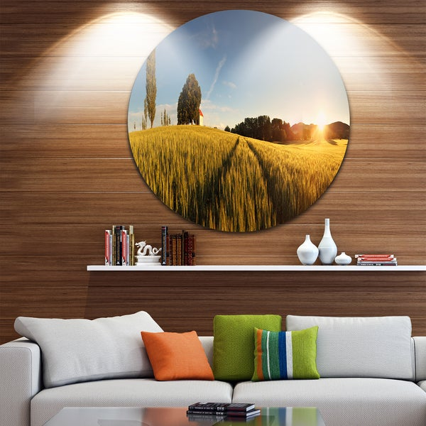 Designart 'Sunset Over Wheat Field in Slovakia' Photography Large Disc Metal Wall art