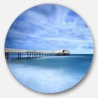 Designart 'Pier Infinite to Blue Sea' Seascape Photo Round Wall Art