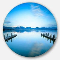 Designart 'Two Wooden Piers in Blue Sea' Seascape Photo Disc Metal Artwork