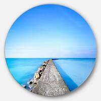 Designart 'Concrete and Rocks Pier' Seascape Photo Circle Wall Art