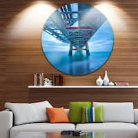 Designart 'Industrial Pier' Seascape Photo Disc Metal Wall Art
