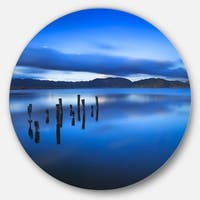 Designart 'Blue Clouds at Evening' Seascape Photo Round Metal Wall Art