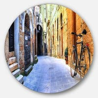 Designart 'Pictorial Street of Old Italy' Cityscape Round Wall Art