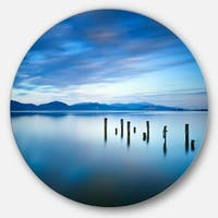 Designart 'Cloudy Sky in Blue Sea' Seascape Photo Large Disc Metal Wall art
