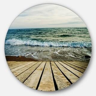 Designart 'Wooden Pier in Waving Sea' Seascape Photo Disc Metal Wall Art