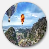 Designart 'Mountains and Balloon Landscape' Photo Disc Metal Artwork