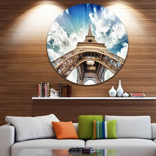 Designart 'Eiffel Tower with Fast Moving Clouds' Photography Circle Wall Art