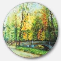Designart 'Bridge in Colorful Forest' Landscape Painting Disc Metal Artwork