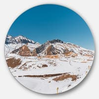Designart 'Winter Mountains in Azerbaijan' Landscape Photo Large Disc Metal Wall art