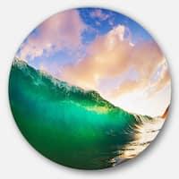 Designart 'Waves under Cloudy Sky' Seascape Round Wall Art