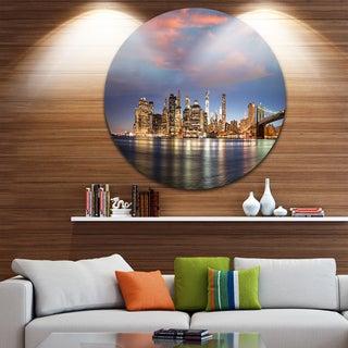 Designart 'Manhattan at Nighttime' Cityscape Photography Round Wall Art