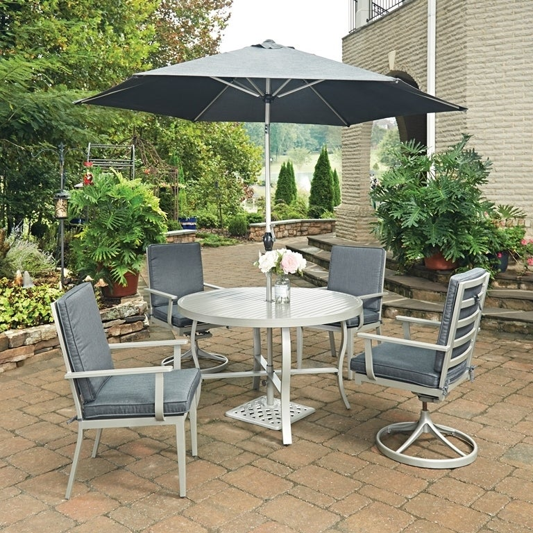 South Beach 7 Pc. Round Outdoor Dining Table& 2 Swivel Ro...