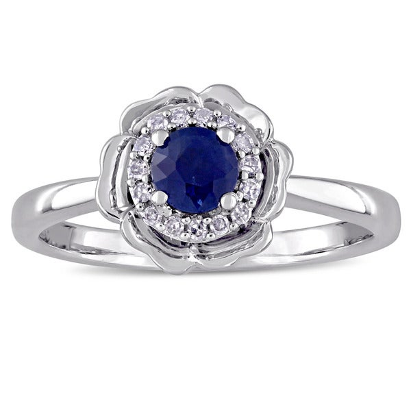 Laura Ashley Sapphire and 1/10ct TDW Diamond Halo Flower Ring in 10k White Gold (G-H,I2-I3)