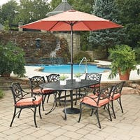 Biscayne Black Oval 9 Pc Outdoor Dining Table, 6 Arm Chairs with Cushions & Umbrella with Base by Home Styles