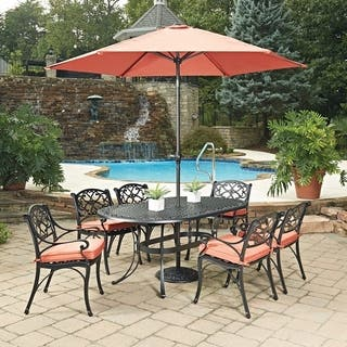biscayne black oval 9 pc outdoor dining table 6 arm chairs with cushions umbrella
