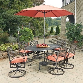 Biscayne Rust Bronze Oval 9 Pc Outdoor Dining Table, 6 Swivel Rocking Chairs with Cushions & Umbrella with Base by Home Styles