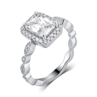 Divina Sterling Silver 3 1/4ct TDW Cubic Zerconia Emerald Cut Engagement Ring.