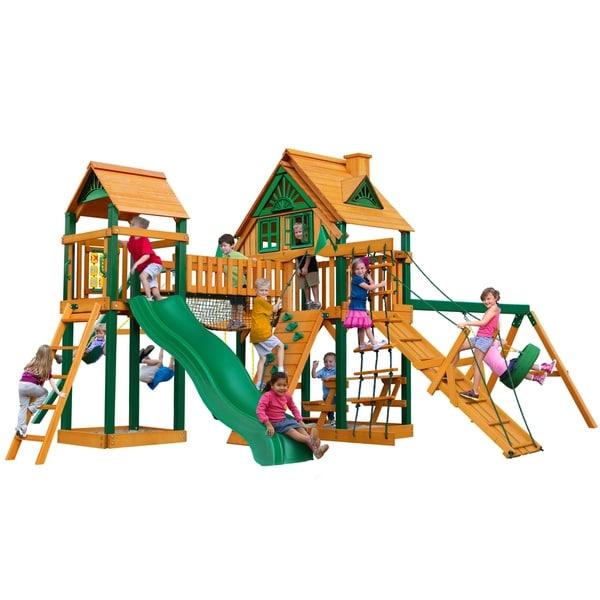 Gorilla Playsets Pioneer Peak Treehouse Cedar Swing Set with Timber Shield Posts