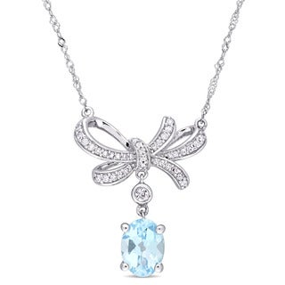 Miadora Signature Collection 10k White Gold Sky Blue Topaz White Sapphire and 1/6ct TDW Diamond Bow Dangle Necklace (G-H, I2-I3)