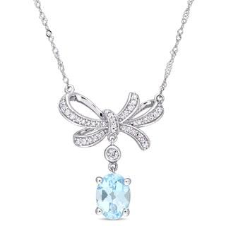 Miadora Signature Collection 10k White Gold Sky Blue Topaz White Sapphire and 1/6ct TDW Diamond Bow Dangle Necklace (G-H, I2-I3)
