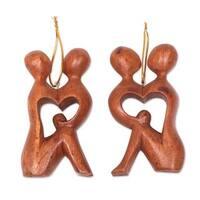 Handmade Pair Wood Ornaments, 'Look Into My Eyes' (Indonesia)