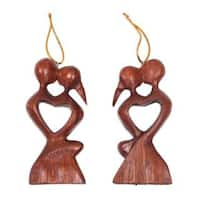 Handmade Pair Wood Ornaments, 'Kissing Heart' (Indonesia)