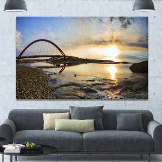 Designart 'Bridge Sunset Panorama' Seashore Wall Art on Canvas - Black
