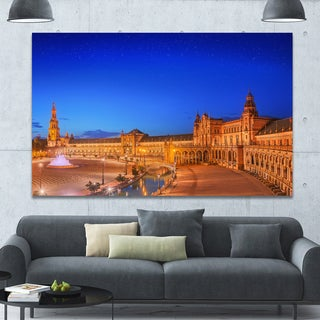Designart 'View of Spain Square at Sunset' Modern Cityscape Wall Art - Blue