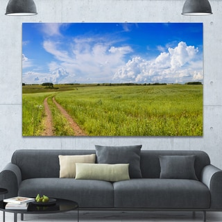 Designart 'Road in Field with Green Grass' Extra Large Landscape Canvas Art Print