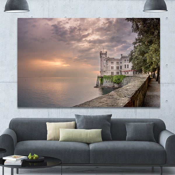 Designart 'Miramare Castle at Sunset' Extra Large Landscape Canvas Art Print - Multi-color