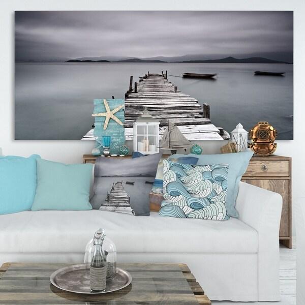Designart 'Pier and Boats at Seashore' Bridge and Pier Canvas Wall Art
