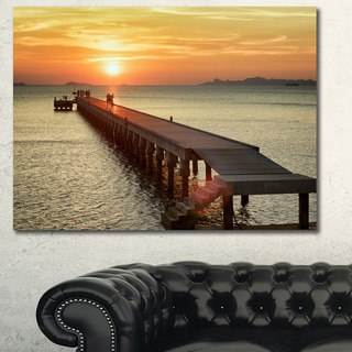 Designart 'Boat Pier at Sunset' Bridge and Pier Canvas Wall Art