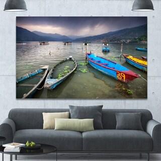 Designart 'Boats near Pokhara Lake' Boat Canvas Wall Art - Blue