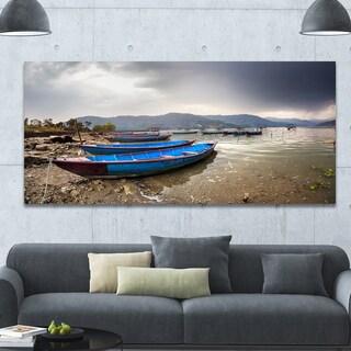 Designart 'Blue Boats in Pokhara Lake' Boat Canvas Wall Art - Brown
