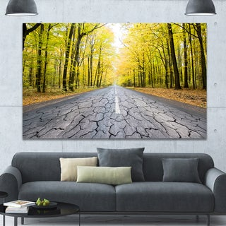 Designart 'Cracked Road in the Forest' Extra Large Landscape Canvas Art Print - Yellow