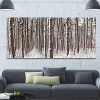 Designart 'Dense Pine Forest in Winter' Large Landscape Canvas Art Print - Multi-color