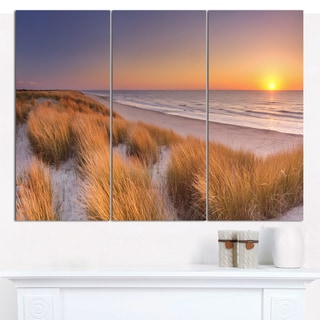 Designart 'Sunset on Texel Island Beach' Multipanel Seashore Canvas Wall Art - 3 Panels 36x28