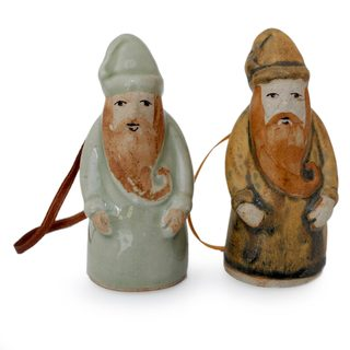 Handmade Pair of Celadon Ceramic Christmas Ornaments, 'Thai Santa Claus' (Thailand)