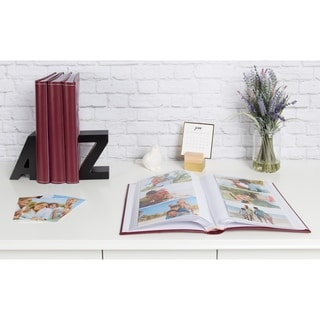 Link to DesignOvation Debossed Black Faux Leather Photo Album (Pack of 4) Similar Items in Albums