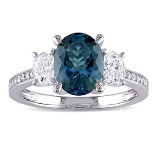 Miadora Signature Collection 14k White Gold London Blue Topaz 5/8ct TDW Oval and Round Diamond Engagement Ring (G-H, I1-I2)