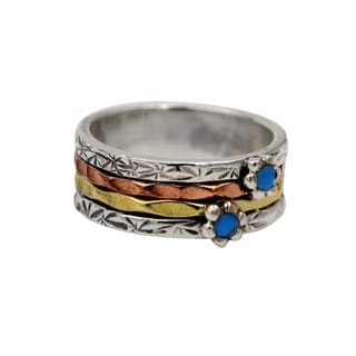 sterling silver copper brass spinner ring with turquoise flower design detail