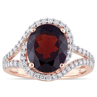 Miadora Signature Collection 14k Rose Gold Oval-Cut Garnet and 1/2ct TDW Diamond Interlaced Halo Rin