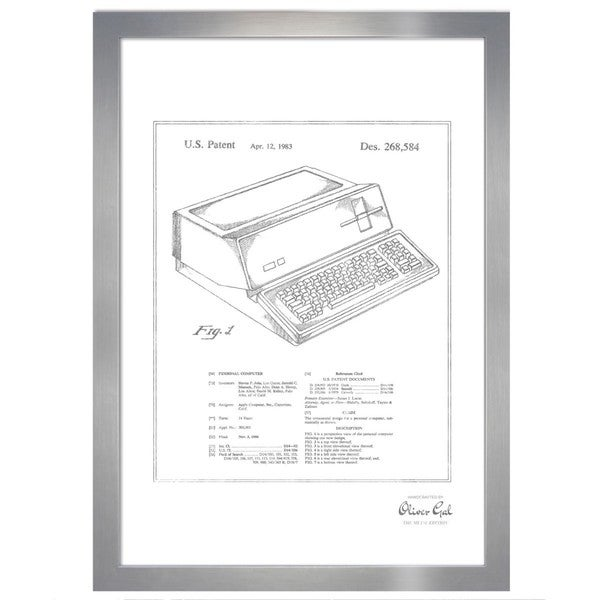 Oliver Gal 'First Apple Personal Computer 1983, Silver Metallic' Framed Art