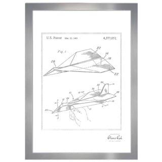 Oliver Gal 'Folded paper airplane 1983, Silver Metallic' Framed Art